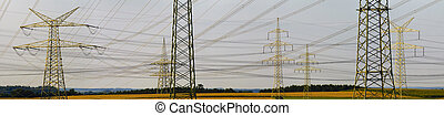 panorama of electric power poles - panorama view over many...