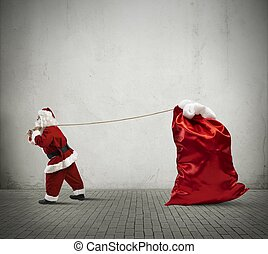 Santa Claus with big sack - Santa Claus pulls a big sack...