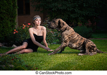 Fashion photo of elegant woman with a big dog