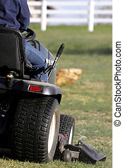 Riding Lawn Mower and Lawn - Cutting a large area of lawn on...