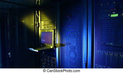 Server room - Working data servers with flashing LED lights