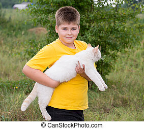Boy with a white cat
