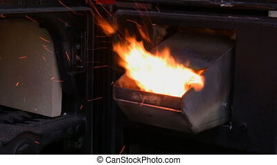 Wood pellet burner - View of an open new modern wood pellet...