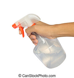 Spraying a cloth with laundry detergent in spray bottle