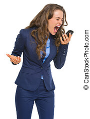 Angry business woman shouting in cell phone