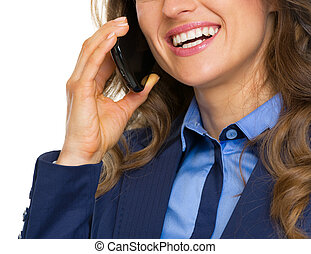 Closeup on happy business woman talking mobile phone