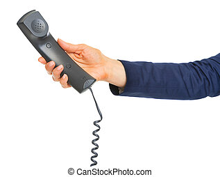 Phone handset in hand of business woman