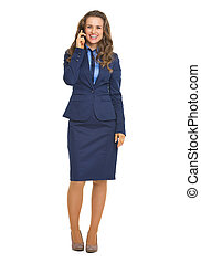 Full length portrait of smiling business woman talking cell phone
