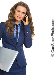 Business woman with laptop talking cell phone