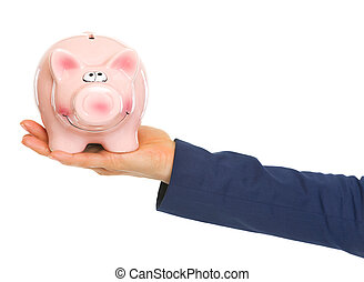 Closeup on hand of business woman holding piggy bank