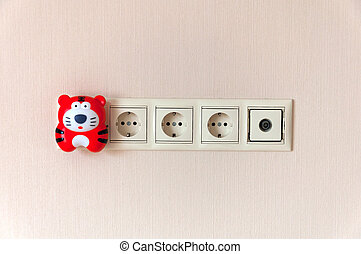 Electric outlet on the wall and a night light