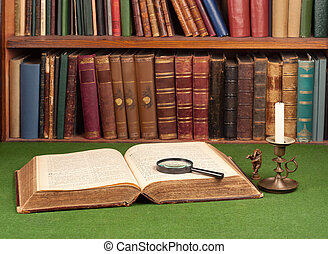 Antique leather books, tin candlestick and magnifying glass...