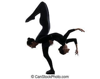 two women contortionist exercising gymnastic yoga silhouette...