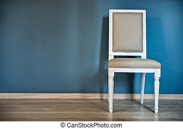 White chair near the blue wall