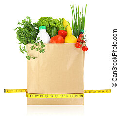 Fresh groceries in a paper bag with measuring tape
