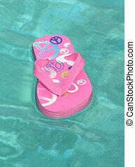 flip-flops - A flip-flop on water
