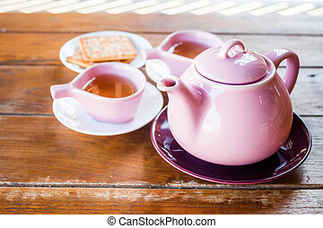 Cups of tea with teapot