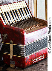 Old accordion - Located on the old accordion red wood tables...