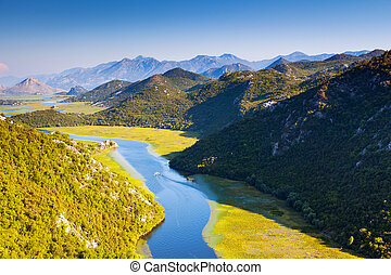 river - Sinuous river flowing through mountains Rijeka...
