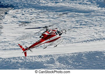Mountain Rescue - Mountain rescue helicopter flying in a...