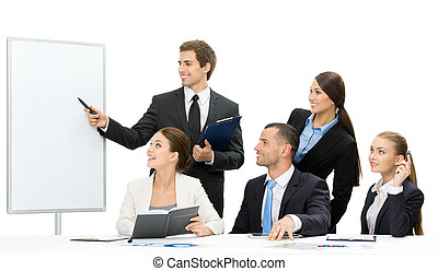 Manager showing something on screen to the group of people