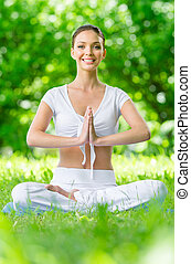 Girl in lotus position prayer gesturing