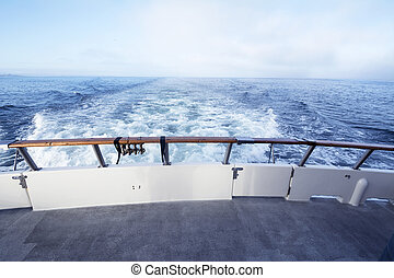 Boat stern - A view off a ship's stern shows the turbulent...