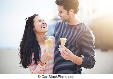 young couple having fun at santa monica pier