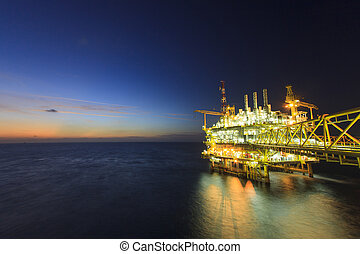 Oil and gas platform - Platform in sunset or sunrise time,...