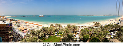 DUBAI, UAE - SEPTEMBER 11: The panoramic view on JBR beach and construction of the 210-metre Dubai Eye on September 11, 2013 in Dubai, UAE. It will be the world's largest Ferris wheel.
