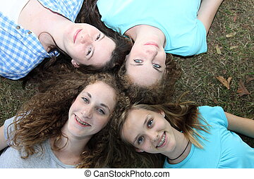 Four smiling attractive teenage girls