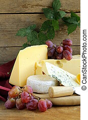 cheeseboard Maasdam, Roquefort, Camembert and grapes for...