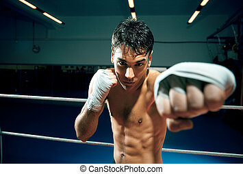 boxing - young adult man boxing in gym. Copy space