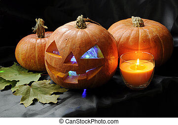 Pumpkin set - Pumpkins in Halloween setting with candle and...