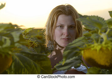 Woman in sun flower field