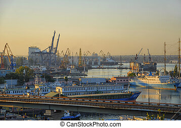 Odessa port at the sunset with cargos and boats