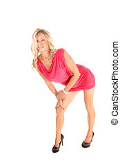 Girl bending down. - A blond young slim woman in a pink...