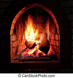 fire in fireplace - flames of fire in fireplace in evening...