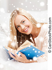 woman reading book - leisure and education concept - smiling...