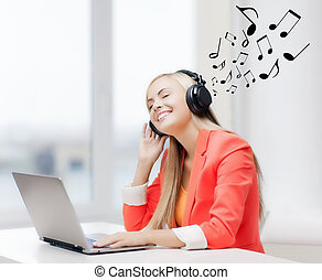 happy woman with headphones listening to music - leisure,...