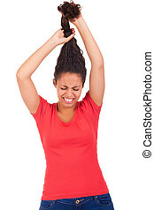 Young african american woman combing hair