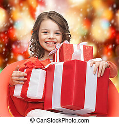 happy child girl with gift boxes - holidays, presents,...