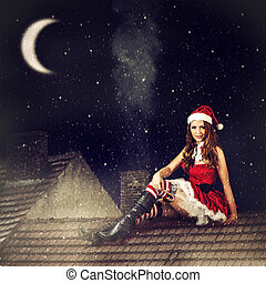 christmas fairy woman in red dress and santa hat - beautiful...