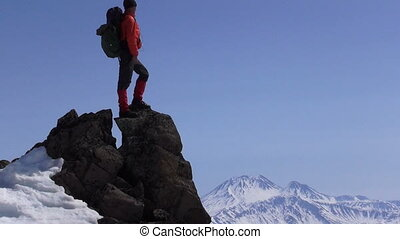 hiker at the top of a rock