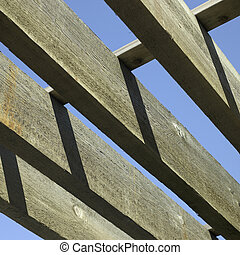 large wooden beams and blue sky