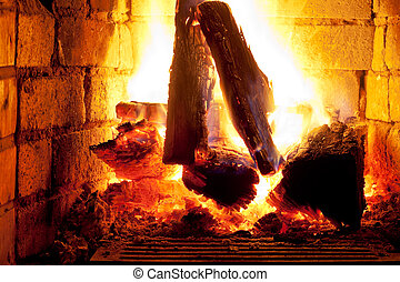 fire in fireplace - burning wood in fireplace in evening...