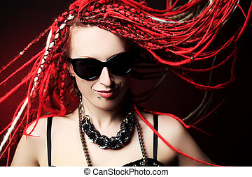 dreadlocks - Portrait of expressive girl with great red...