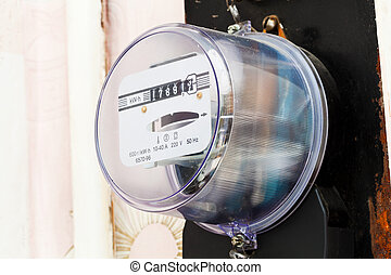 electricity supply meter on wall of living room