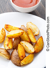 Potato wedges on a plate with tomato sauce