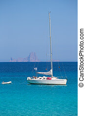 Es Vedra background with sailboat from Formentera - Es Vedra...